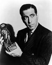Humphrey Bogart with Maltese Falcon in hand