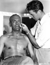 Boris Karloff having makeup applied at Monogram Studios