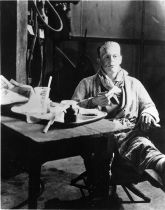 Boris Karloff takes tea in Frankenstein makeup